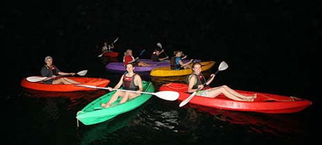 Kayak or canoeing at night time, glow in dark paddles