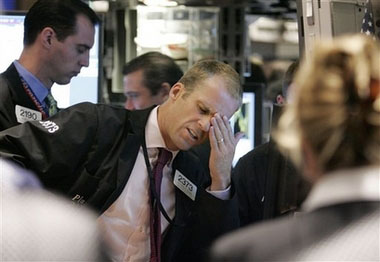 stock trader holding head stressed
